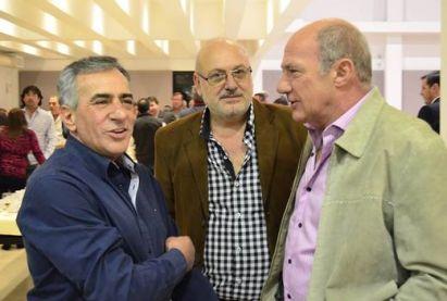 Cariglino, junto a los anfitriones Horacio García y Raúl Guiot, en el Sindicato de Comercio